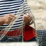 http://www.dreamstime.com/stock-image-old-fisherman-mending-nets-sits-his-fishing-net-image35579741